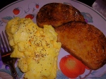 Scrambled eggs with sharp cheddar cheese and homemade bread with butter and honey