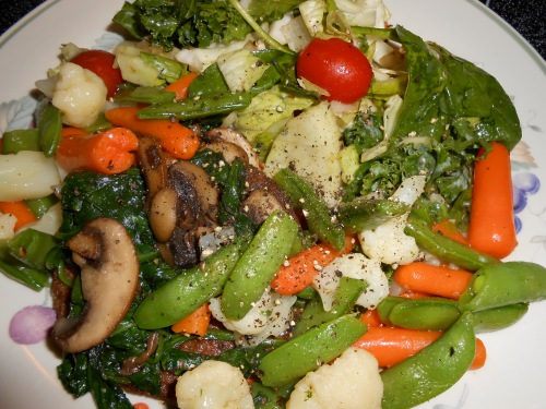 """Veggie Burger - Sauteed Veggies - Mixed Vegetables - Tossed Salad"""